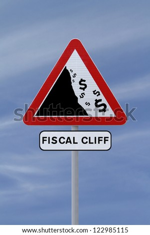 A conceptual road sign on the US fiscal cliff (against a blue sky background) - stock photo