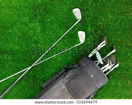 A conceptual studio photo of golfing equipment - stock photo
