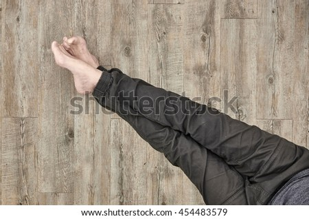 A conceptual studio photof someone sitting on the floor
