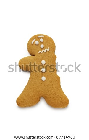 A concerned looking gingerbread man having just lost an arm - stock photo