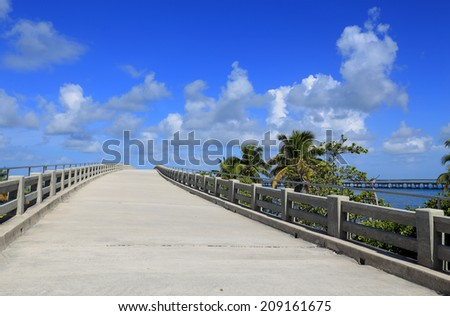 A concrete ramp, part of Florida's historic old Overseas Highway, appears to lead into the sky. - stock photo