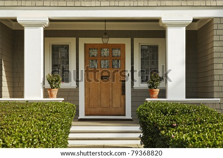 A concrete walkway bordered with hedged shrubs leads to the front door of a home. & Front Door Stock Images Royalty-Free Images \u0026 Vectors | Shutterstock Pezcame.Com
