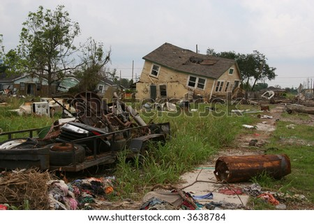 A condemned home and other debris in the 9th Ward of New Orleans, Louisiana, damaged in Hurricane Katrina. - stock photo