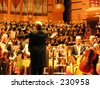 A conductor in front of his Orchestra and Choir - stock photo