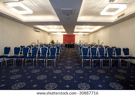A conference and meeting room with chairs and tables.