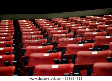 A conference room full of red seats - stock photo