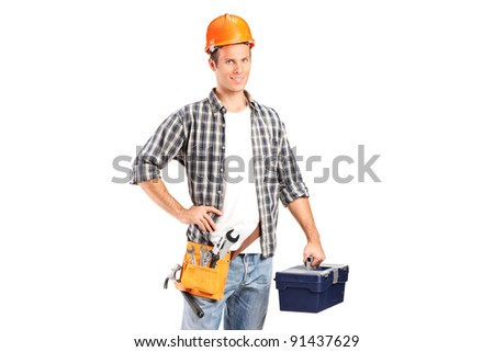 A confident and smiling manual worker holding a wrench and a toolbox isolated on white background - stock photo