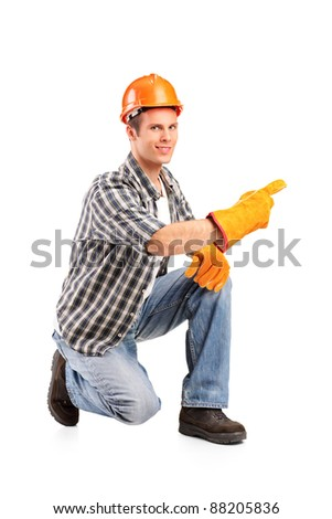 A confident and smiling worker posing isolated on white background - stock photo