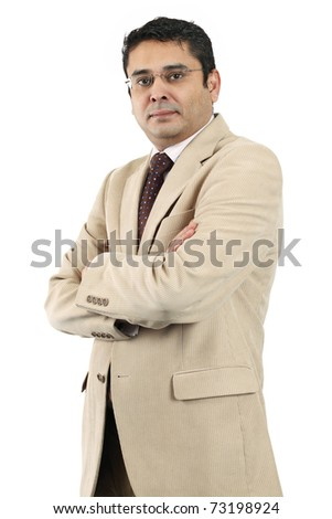 A confident attractive Indian businessman in his late thirties with his arms crossed. - stock photo