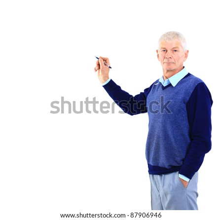 A confident business man writing something with a marker pen - stock photo