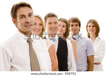 A confident business team of six men and women - stock photo