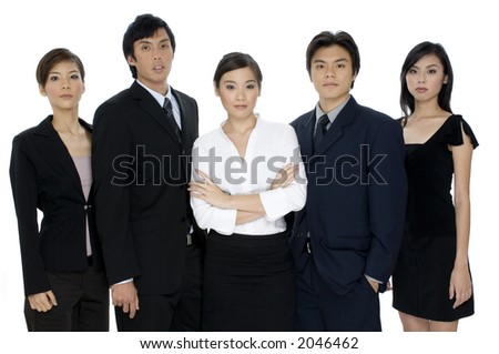 A confident business team of young asian professionals on white background - stock photo