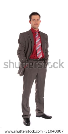 A confident businessman standing in front of a plain white background.