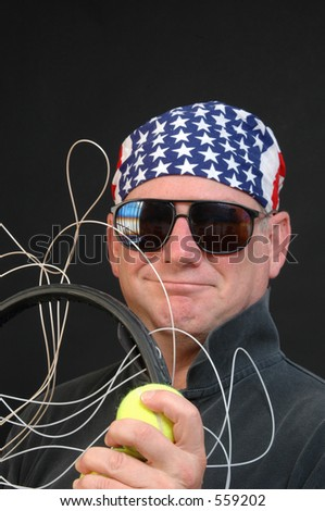 a confident guy with a tennis frame that needs to be restrung - stock photo