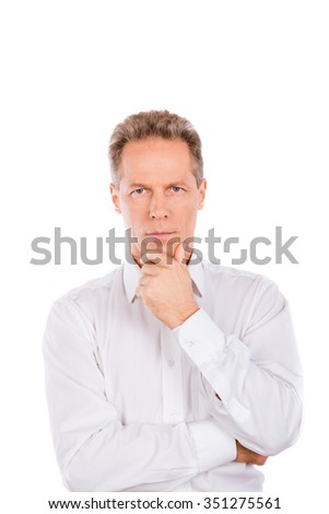 A confident man in a white shirt  standing on the white background - stock photo