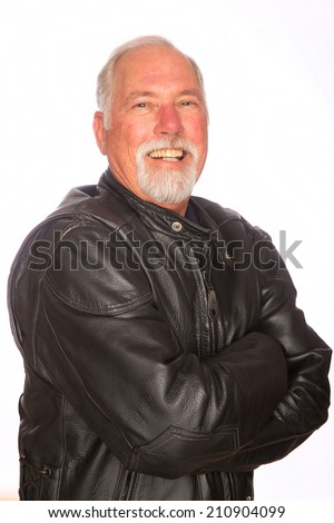 A confident mature man wearing a leather motorcycle jacket - stock photo