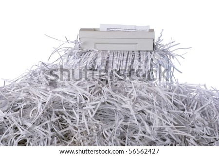 A confidential document being put through a shredder