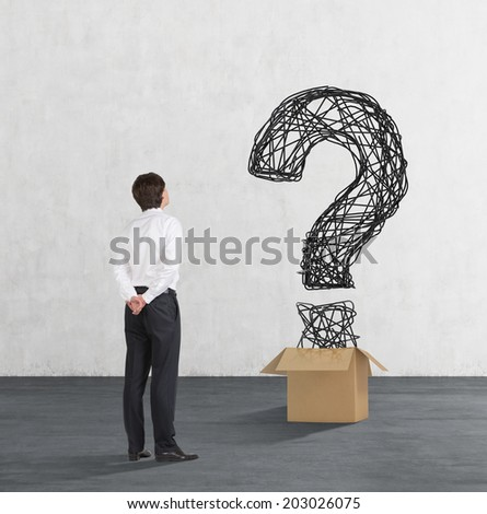 A confused businessman examines hidden risks of business development. - stock photo