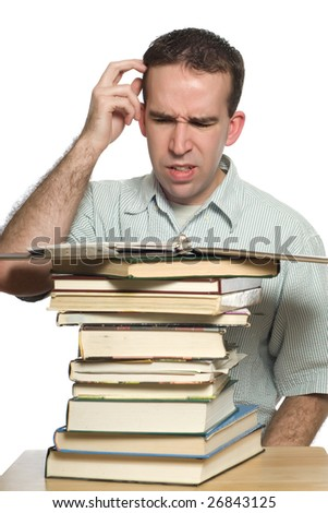 A confused student scratching his head as he tries to study his notes, isolated against a white background - stock photo
