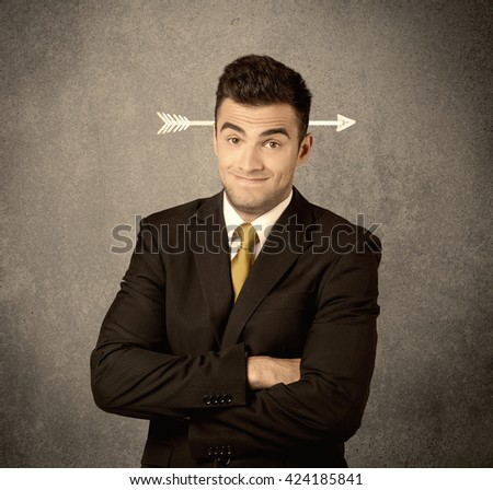 A confused young business guy giving thumbs up with a drawn arrow going through his head concept - stock photo