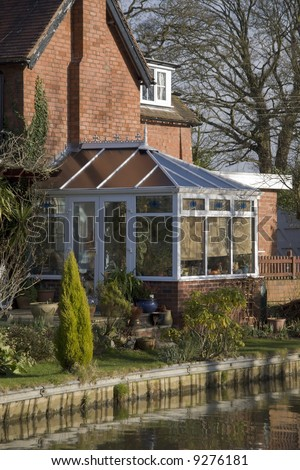 A conservatory  room in house next to garden - stock photo