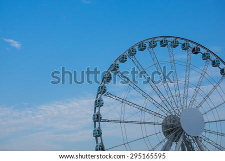 A Constructing Ferris Wheel with Blue Sky in Hong Kong