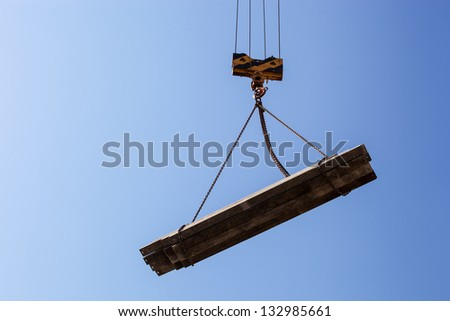 a construction crane to carry loads on a building site
