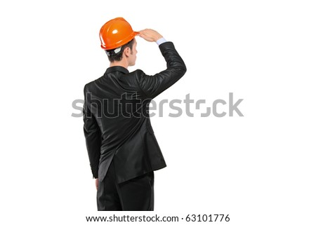 A construction engineer in a suit looking isolated on white background