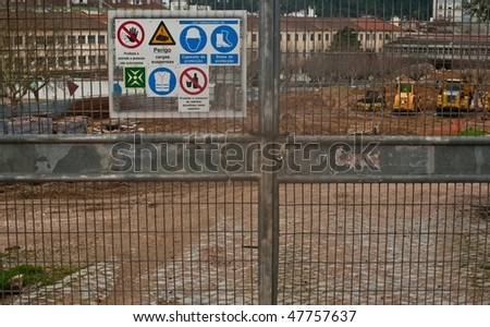 A construction gate, with various safety symbols. - stock photo