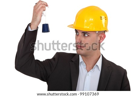 a construction manager watching a lead