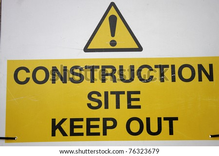 A construction sign posted outside of a work site