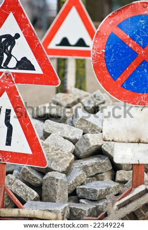 a construction site with a lot of street signs - stock photo