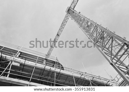 A construction site with concrete slabs built held together with scaffolding - stock photo