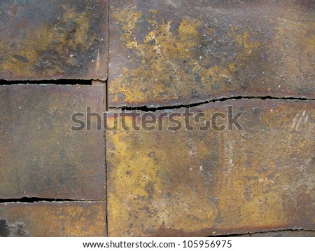 A construction with old rusted metal plates - stock photo