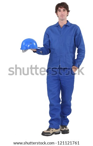 A construction worker dressed all in blue.