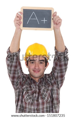 A construction worker holding a slate. - stock photo