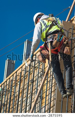 A construction worker on a high wall - stock photo