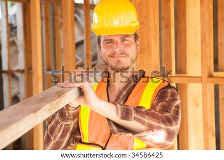 A Construction Worker on the job with a hard hat - stock photo