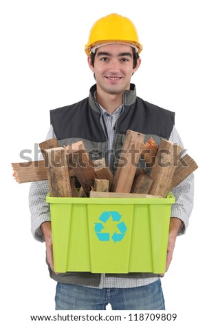 A construction worker recycling wooden scraps.