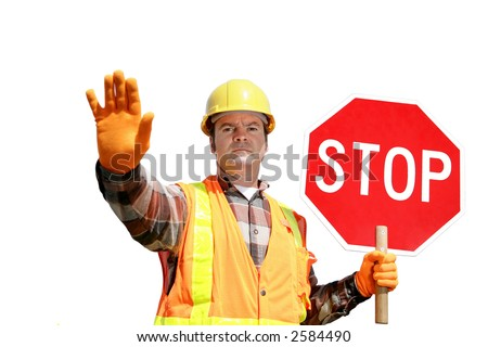 A construction worker stopping traffic, holding a stop sign.  Isolated on white. - stock photo