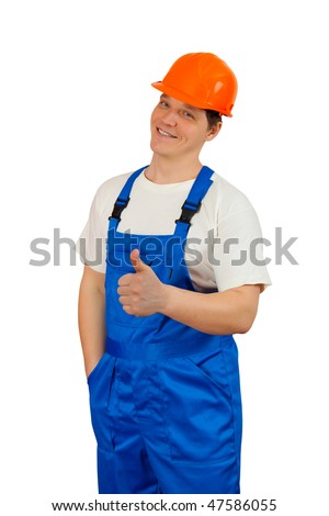 A construction worker wearing a blue denim workwear. Isolated. - stock photo