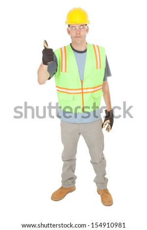 A construction worker wearing gloves gives you the thumbs up sign, signaling that everything is good. Isolated on white. - stock photo