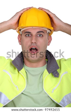 A construction worker who made a mistake. - stock photo