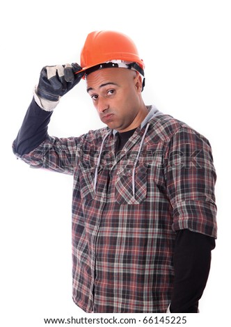 A construction worker with a boring expression. - stock photo