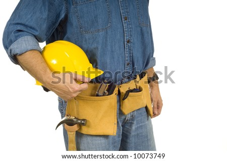 A construction worker with a denim shirt, a tool belt and a protective helmet on a white background