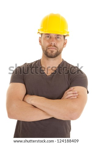 A construction worker with his arms folded and a serious expression on his face. - stock photo