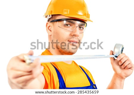 A construction worker working with tape measure. Job, occupation. Isolated over white.  - stock photo