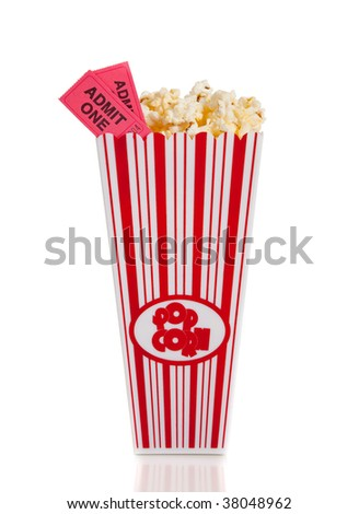 A container of movie popcorn with two tickets on a white background - stock photo