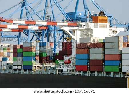 A container ship in port terminal - huge freighter fully loaded - stock photo