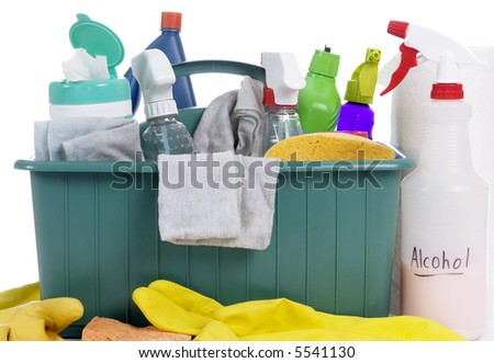 A container with all the daily cleaning supplies.. the chores of labor - stock photo